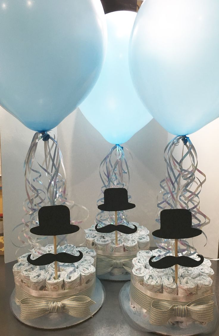 Diaper centerpieces made to order for a mustache themed baby shower. We make custom designs to fit your theme.  Www.delightfulcakesbycecy