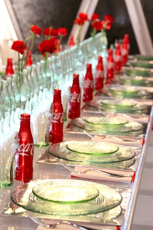 For more red wedding table ideas pinterest.com/... ... coca cola bottles as fun decorations! The Coke bottles/glasses can also be favors