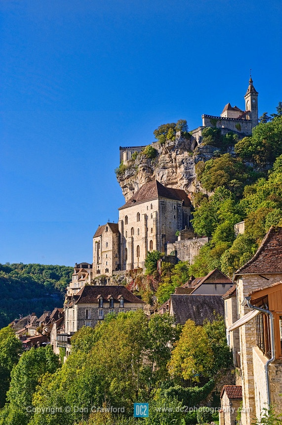 Cliffs of Rocamadour France. Rocamadour has attracted visitors for its beautiful setting in a gorge above a tributary of the River Dordogne, and especially for its historical monuments and its sanctuary of the Blessed Virgin Mary, which for centuries has attracted pilgrims from every country, among them kings, bishops, and nobles.