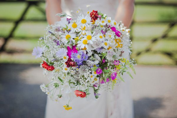 """All the flowers were grown by my mum. These were mainly decided by what would grow and flower at the time! We went for lots of daisies, gerberas and colourful wild flowers to keep it bright. My cousin put the bouquets together for us."" - nice mix of colours"