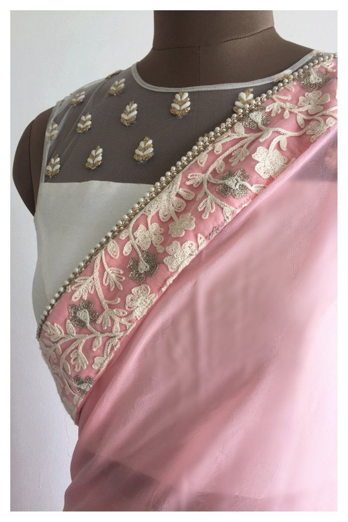 A soothing shade of carrot pink makes this viscose georgette sari a must have. Finished with pearl edges, it's perfect for day events or an elegant night out.