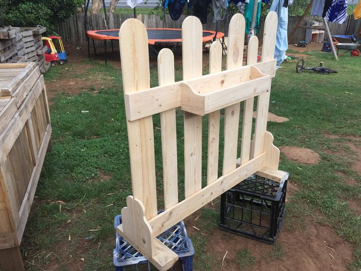 Pallet fence with planter box.. all recycled..