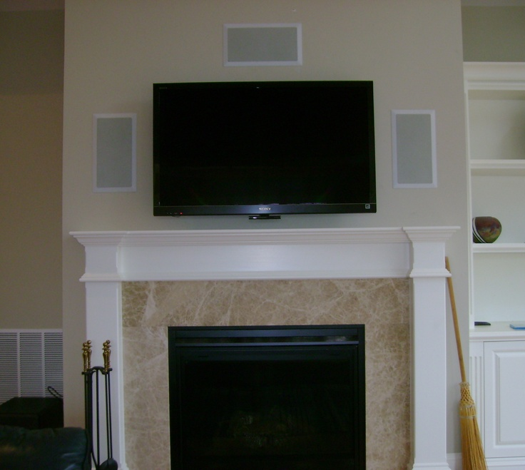 TV above Fireplace with In Wall Speakers. Fireplace framed ...