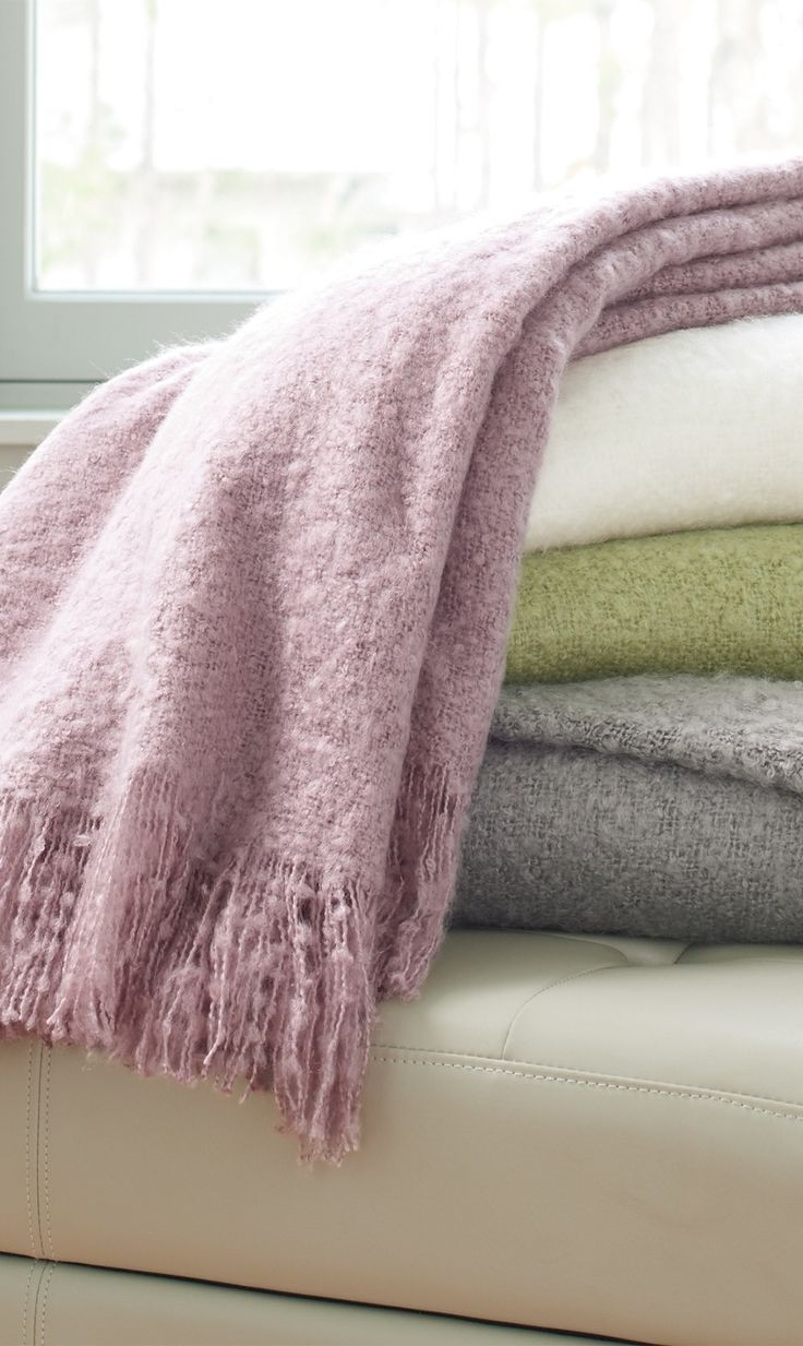 """What throws us is, """"can real fabulousness be called faux?"""" We feel the name Faux Mohair Throw should incorporate more respect."""