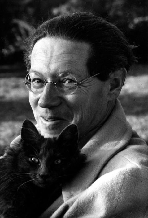 Lion Feuchtwanger (German novelist) enjoying a pleasant moment with one of his cats. Photo by Florence Homolka