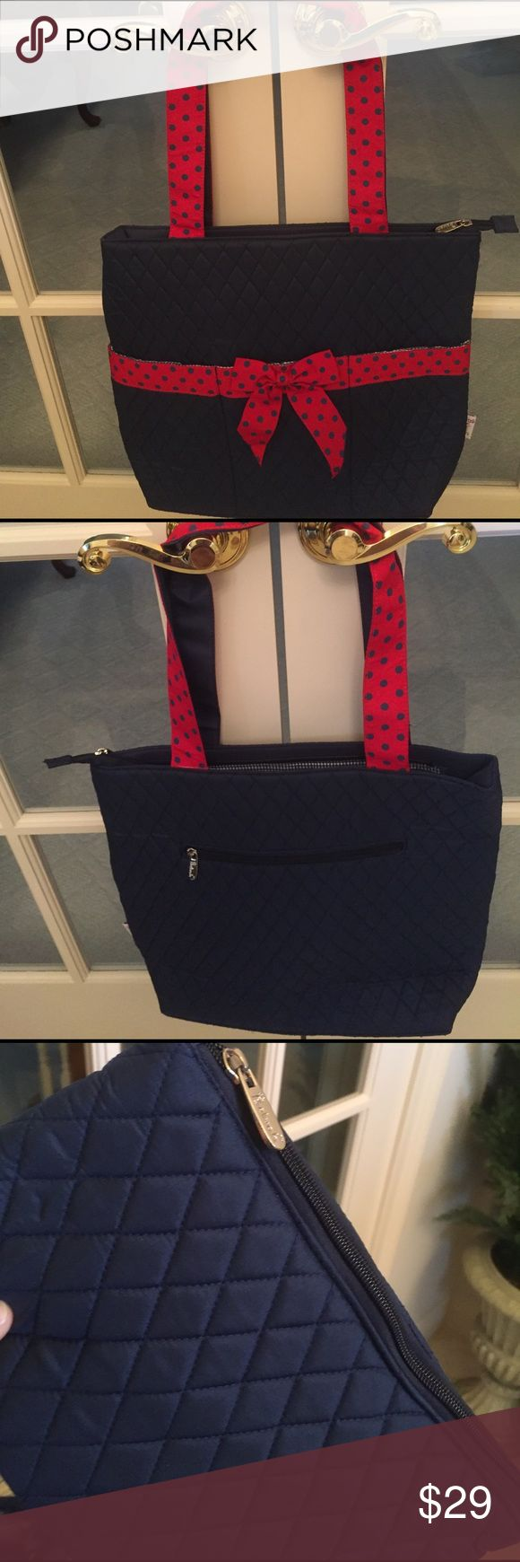 NWT - Tote / purse / diaper bag I myself use this style  bag as a purse.  It is very versatile as I comes with a cosmetic bag and a changing pad. Bags Totes