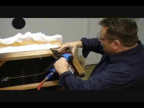 video that includes upholstering corner pads on chair arm/leg