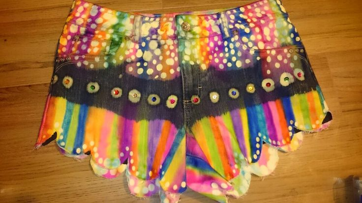 Shorts diy. Made from old jeans. Dip dyed in bleach. Coloured with sharpies and metho. Dotted bleach and sewn sequins