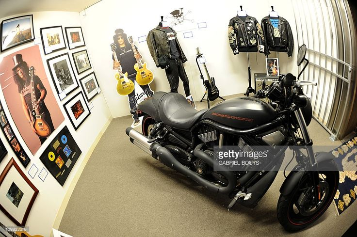 Slash's items are on display during the preview of the sale of exclusive property from legendary guitarist and musician of Guns N' Roses and Velvet Revolver at Julien's Auctions in Beverly Hills, California on March 7, 2011. Included in the auction sale are some of the iconic, Grammy-winning, rock guitarist and songwriter's famous guitars, memorabilia, vehicles and personal furniture and décor from his Hollywood Hills residence.