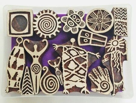 ...tribal art carved on wooden printing blocks