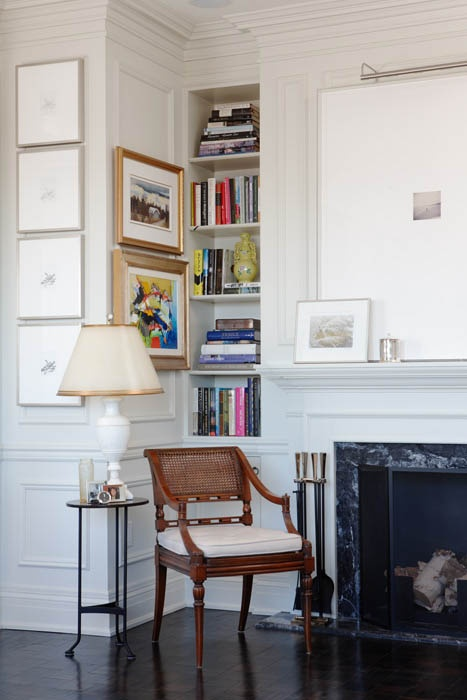 mantel art with oversized mat and picture lighting. great little bookcase as well.