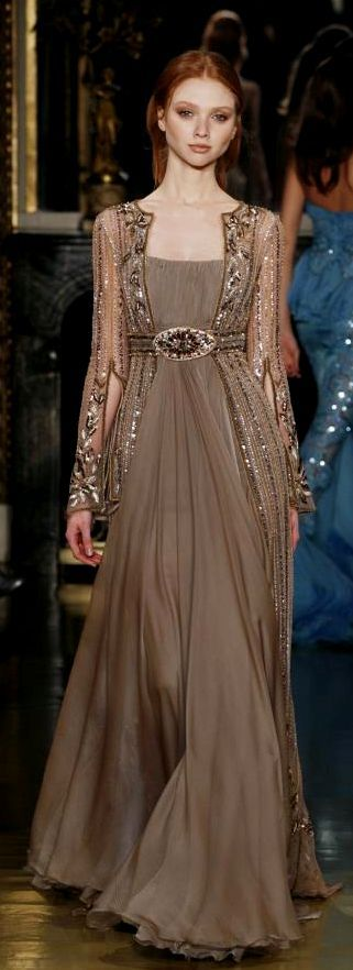 I don't know who the designer is (the previous pinned had no name) but I love this dress..