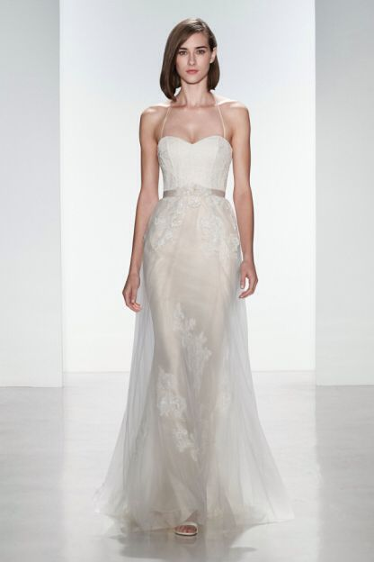 Trending This Christos Heidi wedding dress is pure elegance The sheath gown is made from a blush color with a sheer ivory color tulle overlay A Gorgeous gown