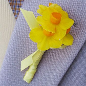 Choose the ultimate spring flower—a yellow narcissus—for a cheerful boutonniere for your groom, Fritts Rosenow for Rosenow Floral Design, rosenowfloral.com.