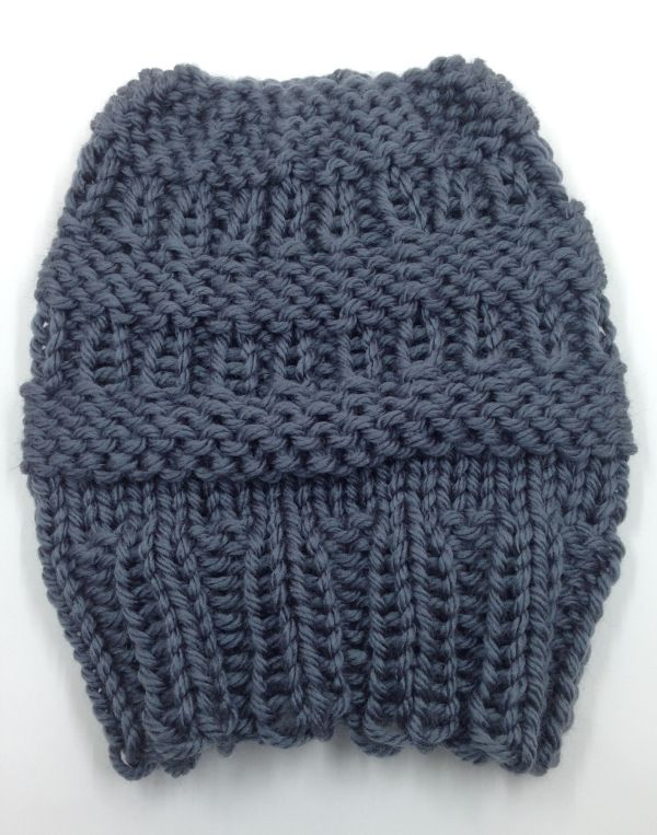 """The Messy Bun hat allows you to keep your """"do"""" intact while keeping you nice and toasty. My daughter sports a messy bun almost every day, so a messy bun hat was a must for our freezing Utah winters. Materials Knitting loom: KB Hat Loom, set at large gauge with 40 pegs. Yarn: Approx 90 yds of bulky weight blend acrylic/wool yarn. Sample was knit with Mighty Stitch Bulky in Ash. Notions: knitting tool, tapestry needle. Other: Oval Cord Elastic by Dritz, about 1 yard. Used for bind off method…"""