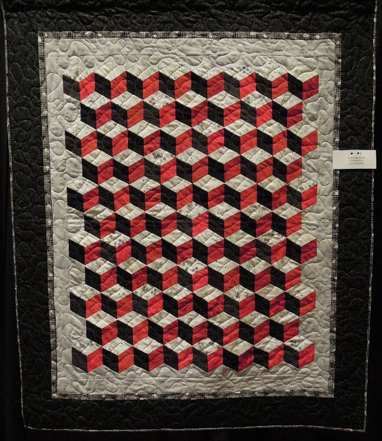 Quilts of illusion:  tumbling blocks. (Lisa, one of the characters in Ann Lingard's novel The Embalmer's Book of Recipes, is given a quilt somewhat similar to this - though older, and with darker blues and reds.)