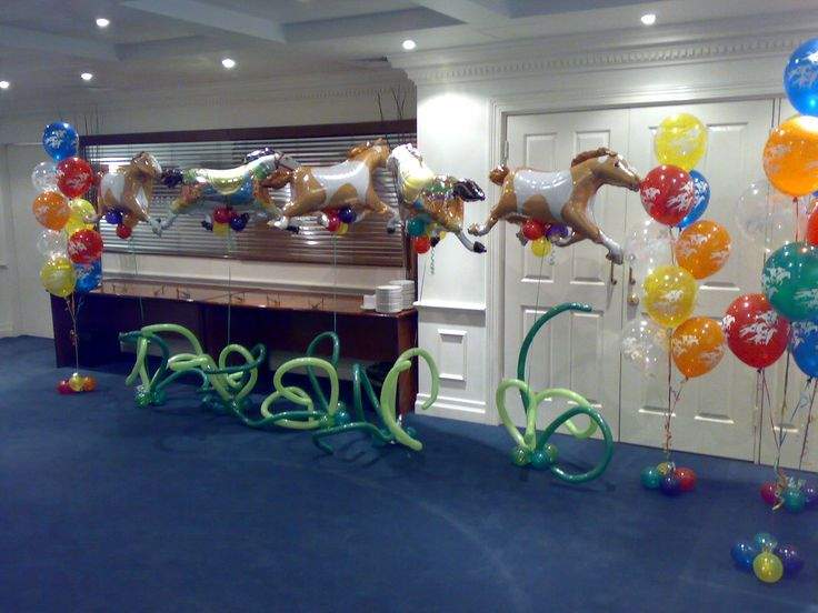 A few different types of our Melbourne cup balloon arrangements - horse and jockey print latex, and horse supershape with grass weight