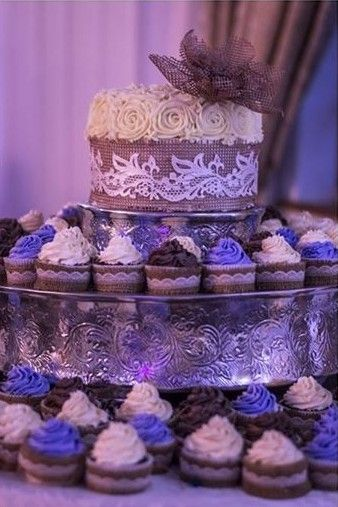 Rustic wedding cake and cupcakes with hessian