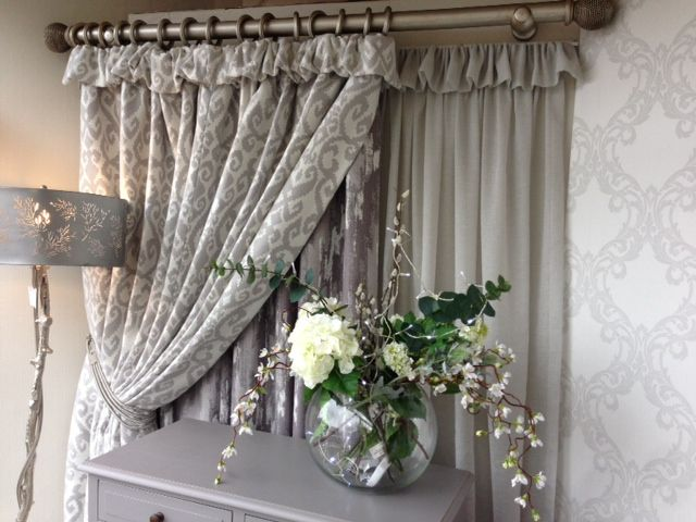 Layered curtains really add depth to this window display