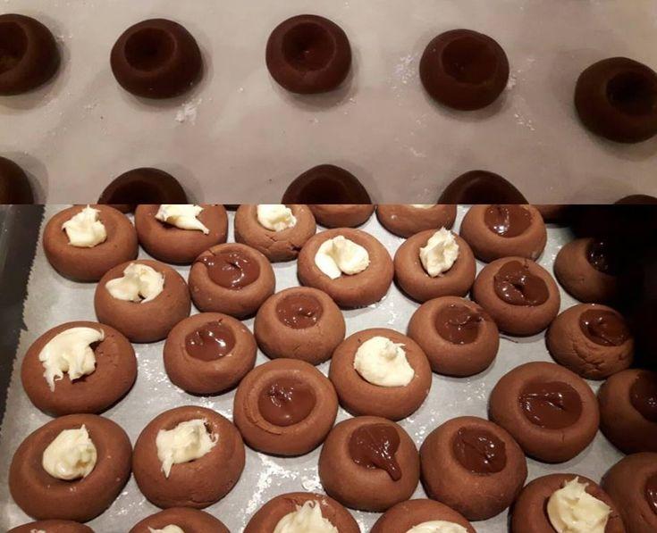Έχεις αυγά, αλεύρι & nutella (No2); Φτιάξε μπισκότα Νutellotti!  εγω εβαλα και λευκη μερεντα στην γεμιση γιατι μας αρεσει πολυ!!!!!!!  Προετοιμασία  10 λεπτά  Ψήσιμο/μαγείρεμα  10 λεπτά  Συνολικός χρόνος  20 λεπτά    Ποσότητα/μερίδες: 16  Υλικά  ΓΙΑ ΤA ΜΠΙΣΚΟΤΑ  ⅔ κούπας nutella (180g)  1 μεσαίου μεγέθους αυγό  1¼ κούπας αλεύρι για