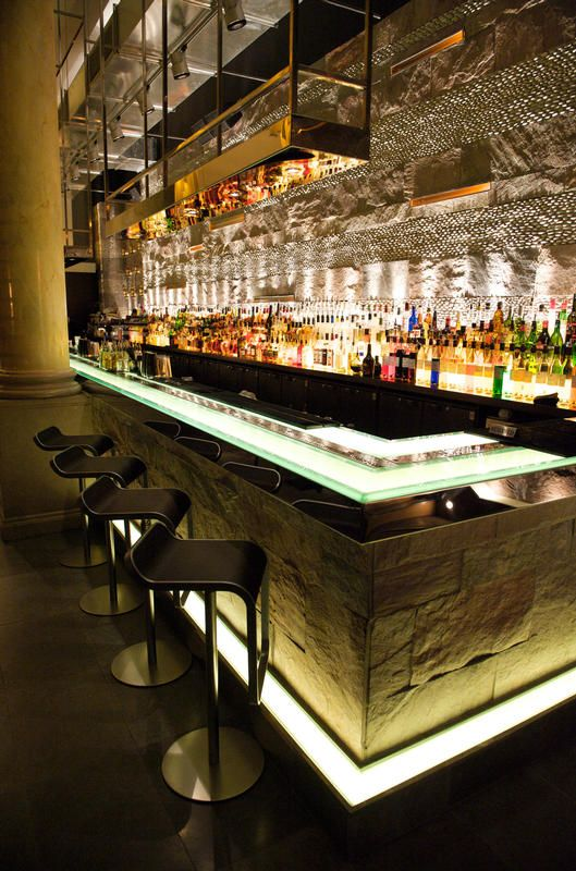 Mint Leaf Lounge, London LIGHTING: into lighting DESIGN: Julian Taylor Associates<----The sleek, modern stools paired with the natural stone of the bar, A+!