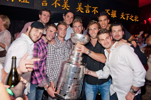 LA Kings with the Cup! (missing player far left..don't recognize...sorry!) L to R, Willie Mitchell, Mike Richards, Trevor Lewis, Alex Martinez, Jeff Carter, Jarret Stoll, Jordan Nolan, Drew Doughty and Brad Richardson