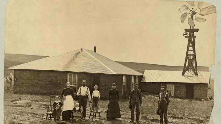 By the late 19th century, families were more established. Here, we see a family standing in front of sod house with a windmill—a fairly high-tech detail—in Coburg, Nebraska in 1884.  15 Tools That Helped Pioneers Survive on the American Frontier