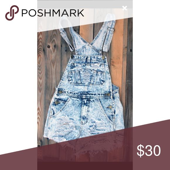 """Denim Shredded Overall Shorts! Denim distressed, shredded overall shorts! Very cute for summer, spring break, and/or music festivals! 💥Size based off of Junior/Lady's contemporary fit! NOT a Women's fit!💥  Only worn twice. From a smoke free home!👑  Medium - approx. a size 2/3 Waist - 14"""" Hips - 17"""" Thigh - 11 1/2"""" Inseam - 2"""" Other"""