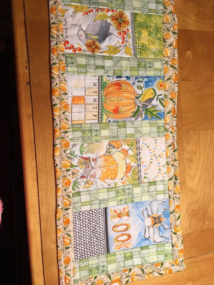 halloween pumpkin table runner size 30 X 13 quilted by StitchesWithDebbie on Etsy https://www.etsy.com/listing/540289357/halloween-pumpkin-table-runner-size-30-x