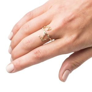 Crafted from rich 10kt solid gold, this Scorpio and water element ring features hand-set white sapphire stars. Scorpio signs (October 23 - November 21), belongi