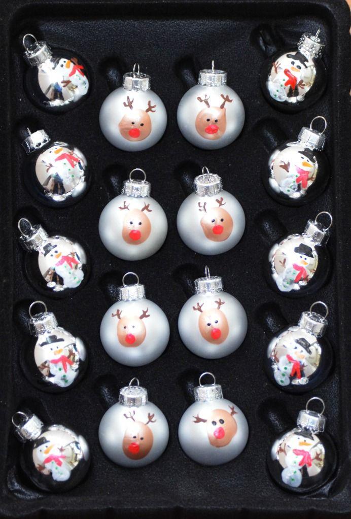 One Artsy Mama - Fingerprint Ornaments DIY http://www.oneartsymama.com/2013/12/fingerprint-ornaments.html