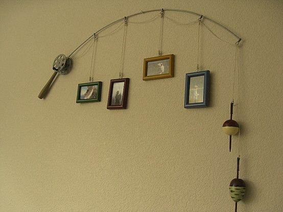 Fishing pole picture hanger. I HAVE to make this for the basement living room!!! Love it!