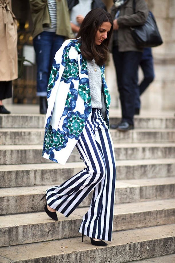 Mix those prints! A great floral coat and perfect striped, wide-legged trousers. 20 More Street Style Snaps From Paris