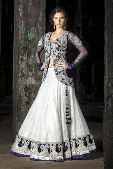 Net ghagra with contrast velvet jacket embellished with zardosi work.