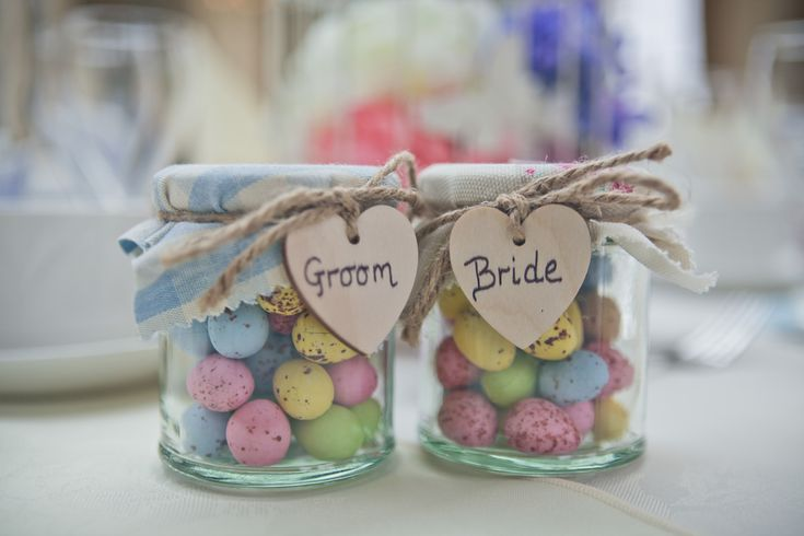 Mini Eggs Easter Themed Wedding Favours and Place Names - jars with mini eggs, fabric, twine and wooden hearts. Bride and Groom. Homemade / DIY / Craft Project