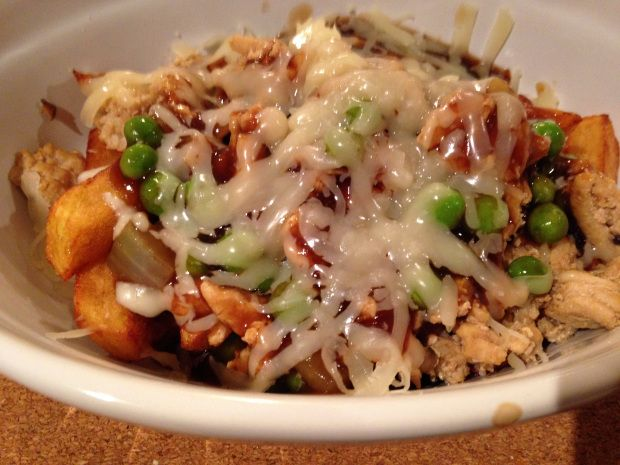 My Poutine with ground chicken, mozza cheese, chicken stock gravy, and home cut fries....comfort food