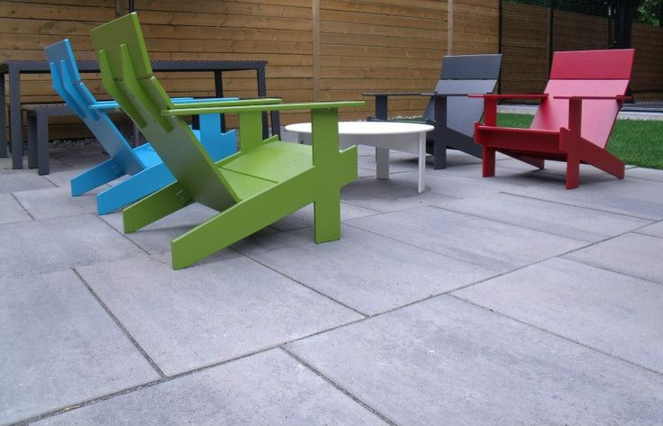 Muskoka chairs on a blu grande patio.