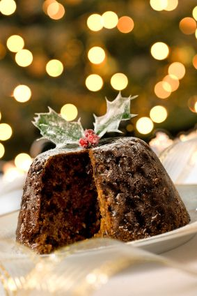 TRADITIONAL STEAMED CHRISTMAS PUDDING:  1 1/2 cp flour,  1 cp sugar,  1 t. cinnamon,  1 1/2 t. baking powder,  1/4 t. salt,  2 eggs beaten,  1/4 cp melted butter,  1/2 cp all-fruit mincemeat,  1/2 cp whole berry cranberry sauce,  1/2 cp pumpkin puree.  Spray pan/mold with Pam, pour in mixture.  Steam 2 1/2 hrs. over large pot with few in. water, on med.  Cook custard, whisking til thick.