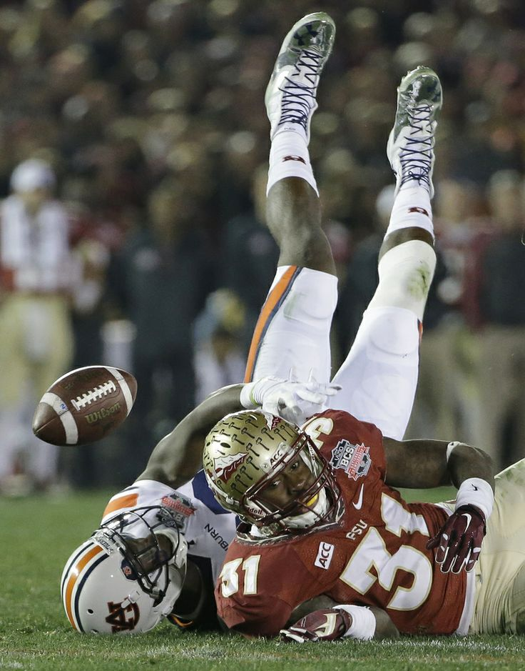 PHOTOS: Auburn vs. Florida State.  FSU's Terrence Brooks breaks up a pass intended for Auburn's Melvin Ray.  Rose Bowl 2014