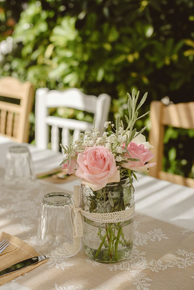 flower arrangement with baby breath, roses in a jar