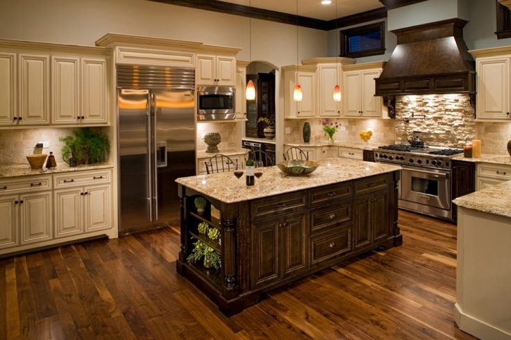 white cabinet kitchen with unique golden oak island and wood tile