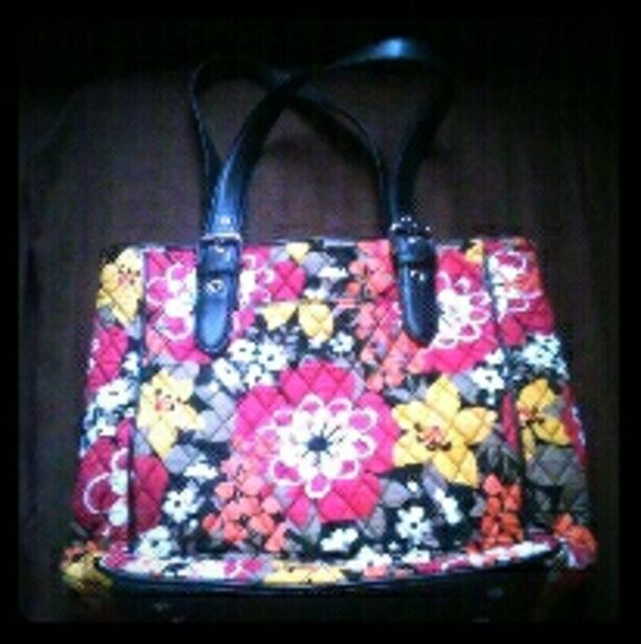 """New Item! Vera Bradley Tote Bag NWOT Brand New with out tags. Large Vera Bradley Tote. 1 Front Pocket, Buckle Straps, 2 Organizer Pockets & a Zipper Pocket Inside, Zips shut on top. Made of Leather & Fabric. Measures Approx: 11""""L X 14.5""""H X 4.5""""W X 11""""SD. Very Cute!  Open To Reasonable Offers! Vera Bradley Bags Totes"""