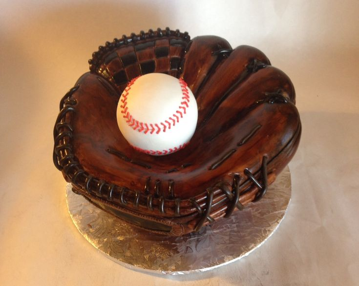 Shaped baseball glove cake with fondant baseball.