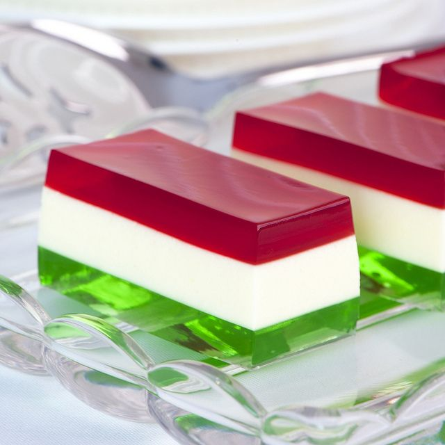 Christmas Jello - I love the clean molded lines of these jello bars. Orange white, and green for St.Pat's; Red, white, and blue for July 4th; Yellows and greens for spring; yellow, orange, red for Autumn... truly endless.
