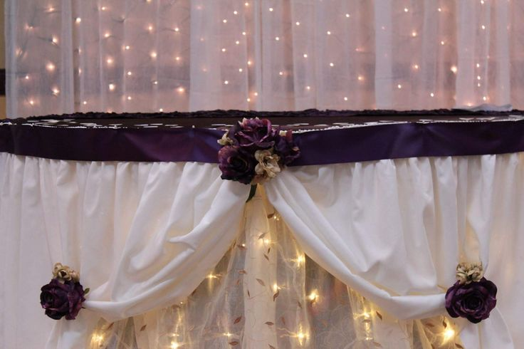 Pipe and Drape in the background with white shear curtain and lights! From The Boutique.