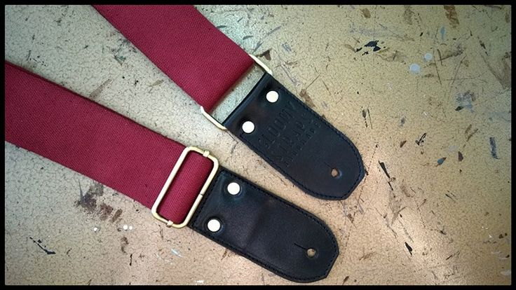 Guitar strap in red belt and black leather with silver accessories, made in Italy