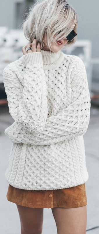 Jacqueline Mikuta wears her gorgeous cream knit pullover with a cute button front skirt.   Sweater: Aran Sweater Market, Skirt: Monki.
