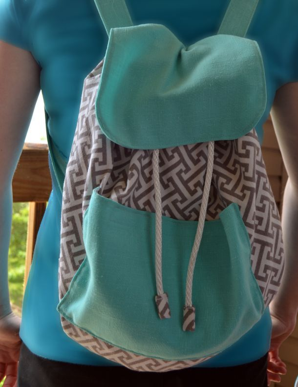 gray and teal drawstring backpack