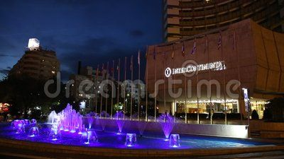 Intercontinental Hotel Bucharest night - fountain illuminated in blue.