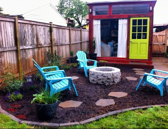 Different take on backyard shed by firepit ...